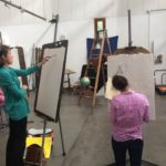 students drawing at easels